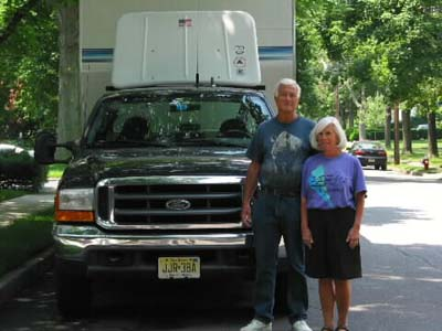 Debby and Charlie in fron to             our truck at our NJ house in 2002
